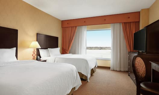 Accessible Guestroom Double Queen Suite with Bed, Outside View, Room Technology, and Work Desk