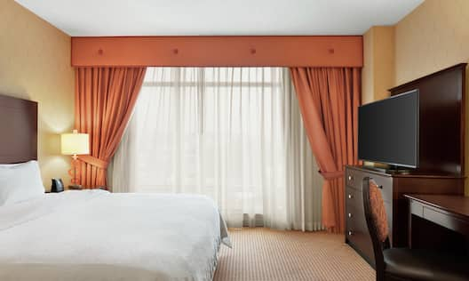 King Guestroom Suite with Bed, Room Technology, and Work Desk