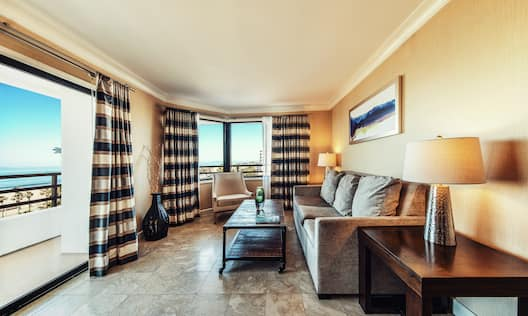 Suite Living Area with Large Windows and Sofa