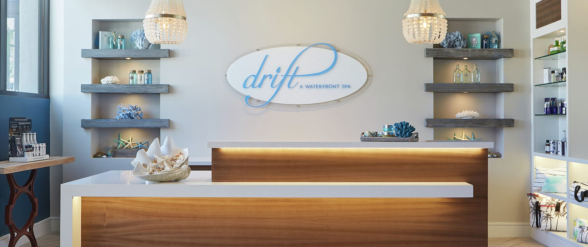 Spa front desk with products on shelves, outside view