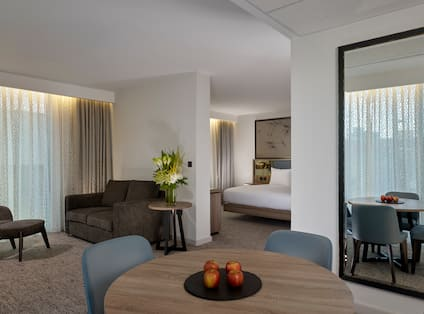 Presidential Suite Living Area and Partial View of Bedroom