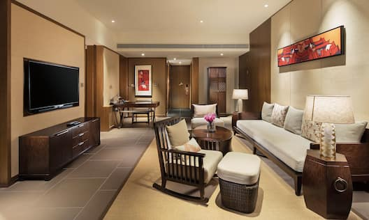 Suite living area with comfortable chair