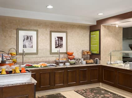 Breakfast Area at Garden Grille with Juices, Fruit  Cereal, and Various Breads