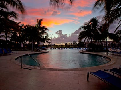 Pool Deck with beautiful sunset inbackground