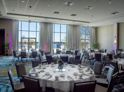 Ballroom Decorated for Wedding with Round Banquet Tables