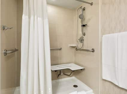 Accessible Guest Bathroom Roll-In Shower with Bench