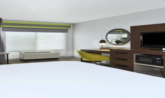 Accessible Guest Room with King Bed, Television, Work Desk and Amenities