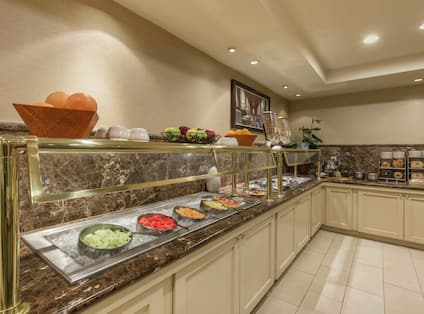 Kitchen with Fruits, Bagels, and Cabinets