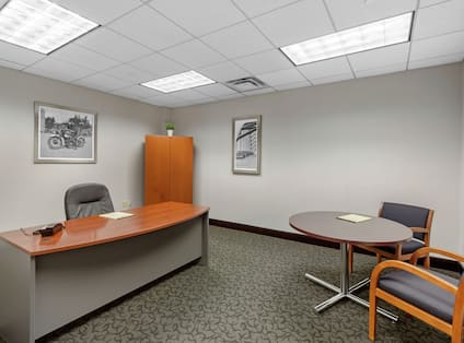 Meeting Room with Tables, Chairs, and a Cabinet