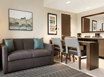 Guest Suite Lounge Area with Sofa and Wetbar Counter