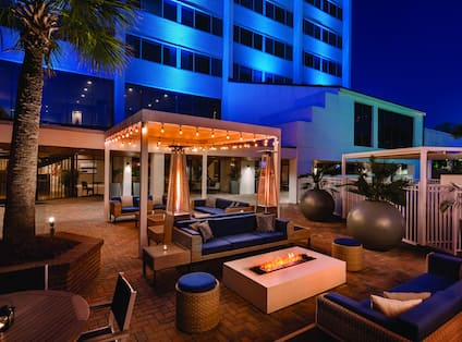 Outdoor Patio With Cabanas Seating At Night