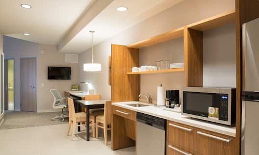 Accessible Queen Room With TV, Work Desk, Dining Table and Kitchen
