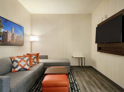Hearing Accessible Two Queen Suite Living
