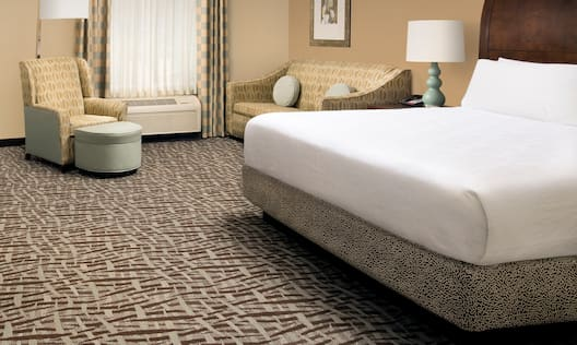 King Bed with Sofa and Armchair Guest Room