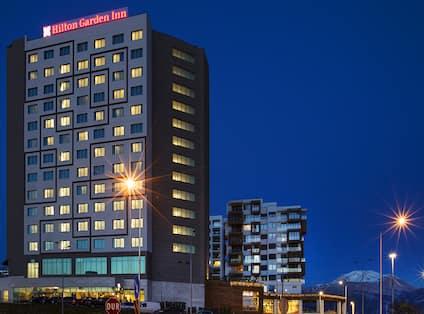 Illuminated Hotel Exterior With Signage at Night