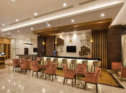 Lounge and Counter Seating at Lobby Bar With TVs