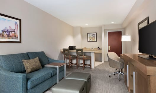 One Bedroom Suite Living Area with wet bar