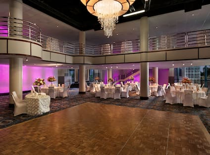 Social Setting with Seating, Tables, and Magenta Lighting in the Savoy Ballroom