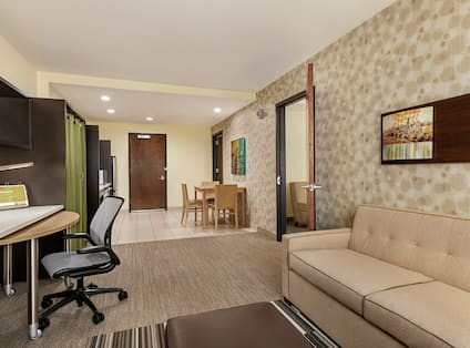 Accessible Suite Living Area with Work Desk and Dining Area