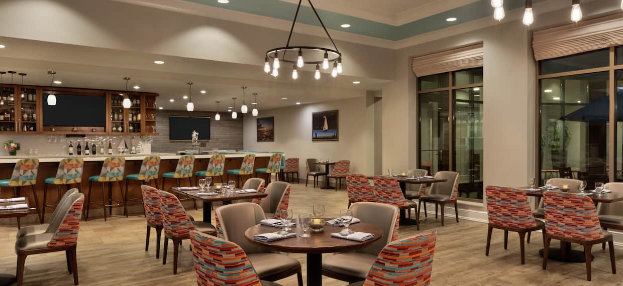 Spacious on-site restaurant featuring welcoming atmosphere, stylish design, and delicious food and drink.