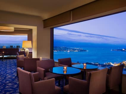 Candle Lit Bar Tables Facing View of Ocean