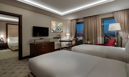 Deluxe Suite Bedroom with Double Twin Beds and Television