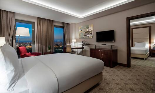 Two Room Guest Suite with Bed and Television