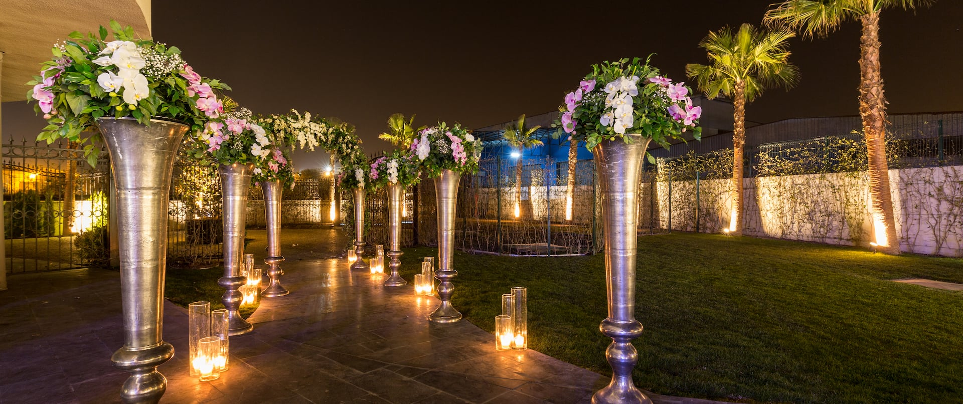 Floral Display and Candles on Walkway Decorated for Night Wedding