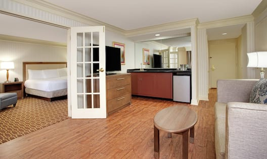 Executive Suite Bedroom and Parlor with Sofa, Television and Kitchenette