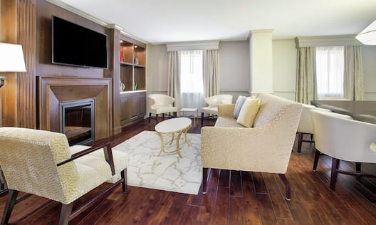 Presidential Suite Lounge Area with Television and Fireplace