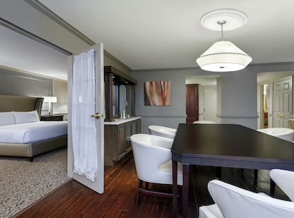 Presidential Suite Parlor with Dining Table and Wet Bar