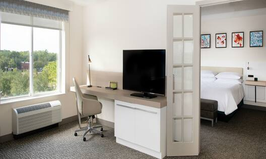 Guest Room with Work Desk, HDTV, and Outside View
