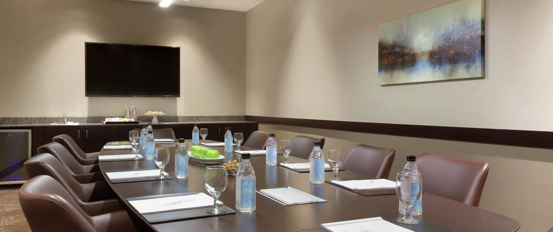 TV and Seating for 10 at Boardroom Table in Meeting Room