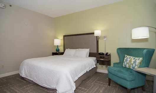 King accessible room with blue arm chair