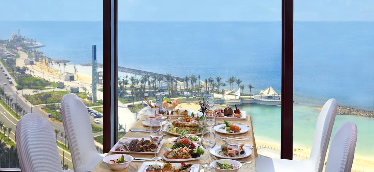 Table by Window with View of Sea, Full Meal Set