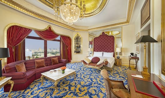 Junior Suite with king bed, lounge area, work desk and city view