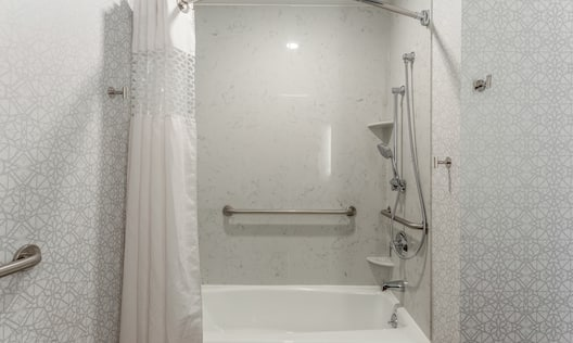 Accessible Guest Bathroom with Tub and Handrails