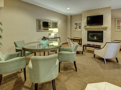Suite Lounge Area with Fireplace and LCD TV