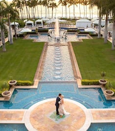 Sunset Bride and Groom Kissing - Pool Fountain Backdrop