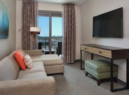 Living Area and Balcony in Hotel Suite