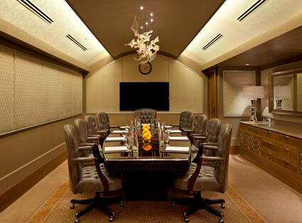 Meeting Room with Large Conference Table, Executive Chairs, and Domed Ceiling