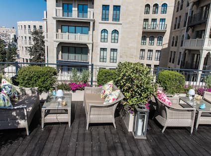 Seating Area on Garden Terrace with Armchairs and Tables