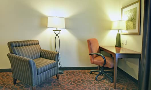 Guestroom with Lounge Chair and Work Desk