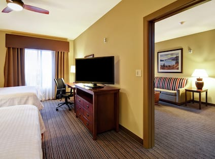 Suite Bedroom with TV and Work Desk