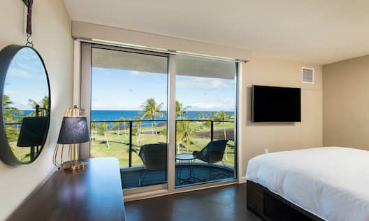 King Suite with Bed, Lounge Area, HDTV, and Ocean View