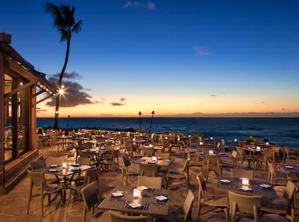 Outdoor Oceanside Restaurant Dining Area at Sunset