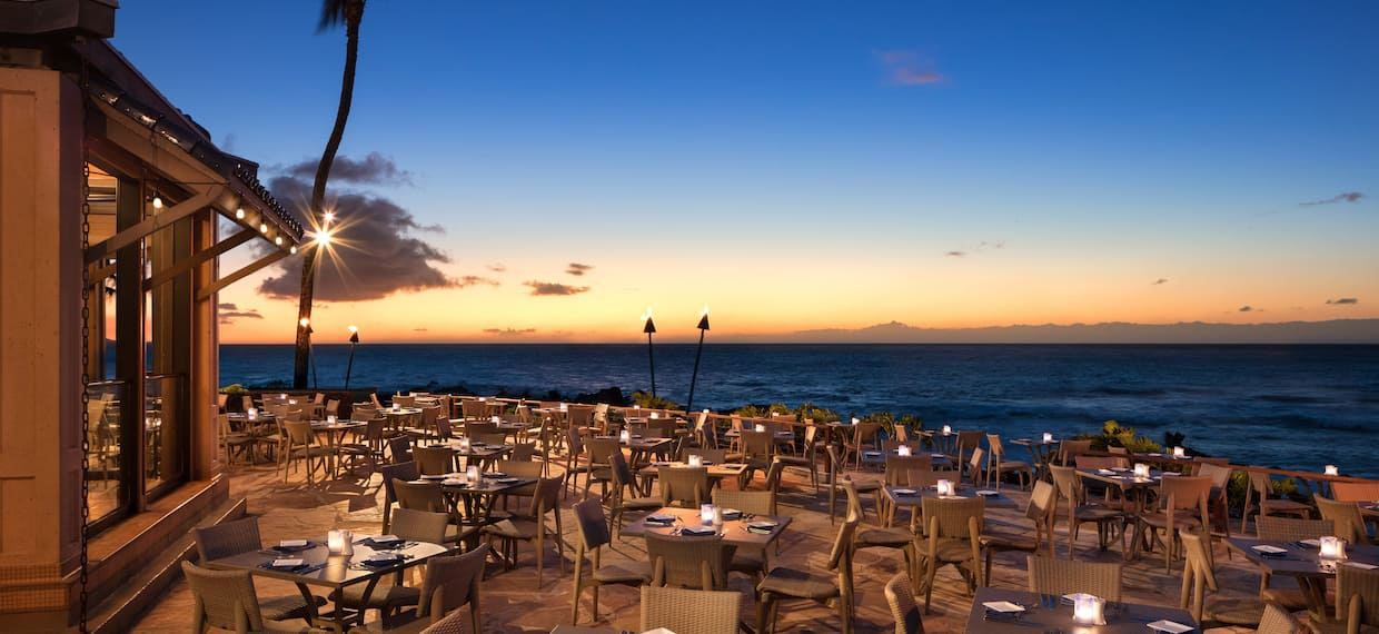 Outdoor Oceanside Restaurant Dining Area at Sunset