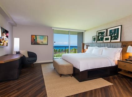 Guestroom with King Bed, Television, Lounge Chair, Ocean View and Balcony