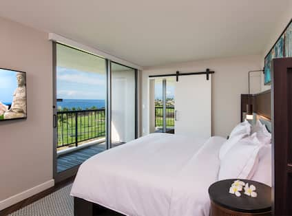 Suite Bedroom with King Bed, Television, Outside View and Balcony
