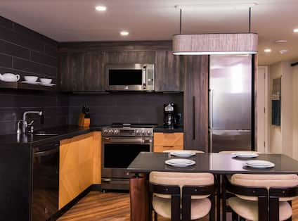 Suite Kitchen with Table, Microwave, Oven, Coffee Maker and Refrigerator